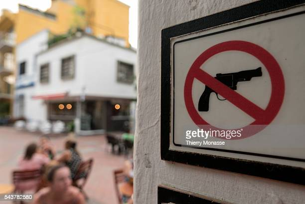 Santa Marta Magdalena Caribbean Region of Colombia Republic of Colombia August 13 2015 A 'No Gun' sign is seen in a cafe of Santa Marta