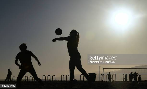 Santa Monica High School students play beach volleyball at Santa Monica beach near where the International Olympic Committee Evaluation Commission...