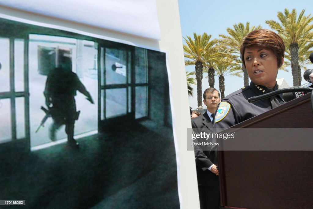Santa Monica Police chief Jacqueline Seabrooks talks to reporters next to a police evidence photo of a suspected gunman entering the Santa Monica College library during his mass shooting spree on June 8, 2013 in Santa Monica, California. The shootings occurred in various locations about three miles south of a political fundraiser attended by President Barack Obama but Secret Service officials said the two events were not related and that the president was never in any danger. Four people besides the gunman have died from their wounds and five others wounded, including a woman who is close to death.