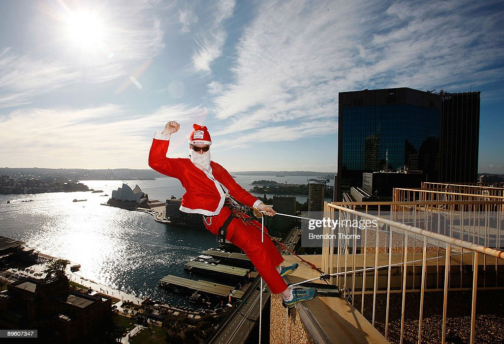 A Santa poses prior to abseiling down the front of Sydney's Four Season's Hotel to launch the Sydney Santa Fun Run on August 5, 2009 in Sydney, Australia. The children's charity Variety are hosting the event on November 29 for which they hope to encourage 5000 Sydney-siders to wear a Santa suit and raise funds for disadvantaged children.