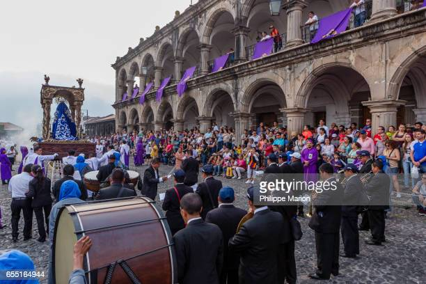 Santa Semana procession carrying religious float (anda) in colonial city square -  Antigua, Guatemala