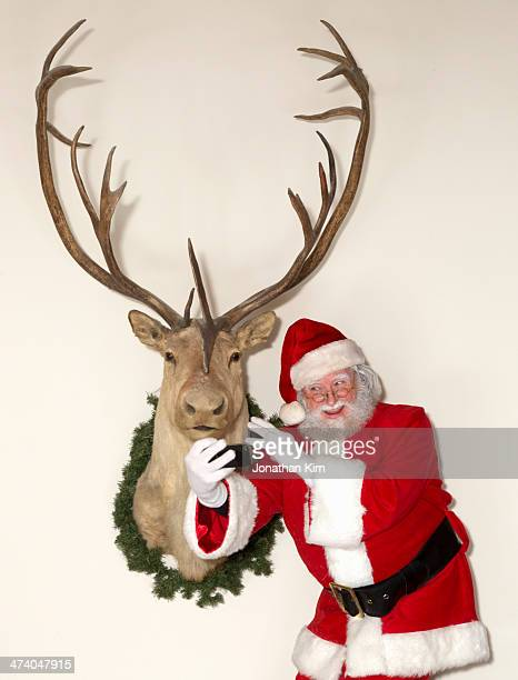 Santa shoots a selfie with a reindeer