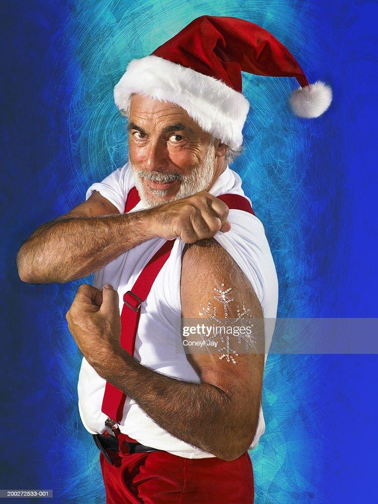 'Santa' showing diamante tattoo on flexed bicep (digital composite) : Stock Photo