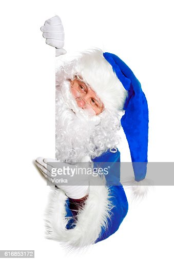 Santa showing something on a blank white banner : Stock Photo