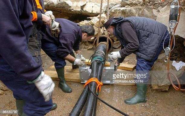 Italian technicians manipulate a hightension undersea cable 14 December 2005 in the port of Santa Teresa di Gallura Italian island of Sardinia...