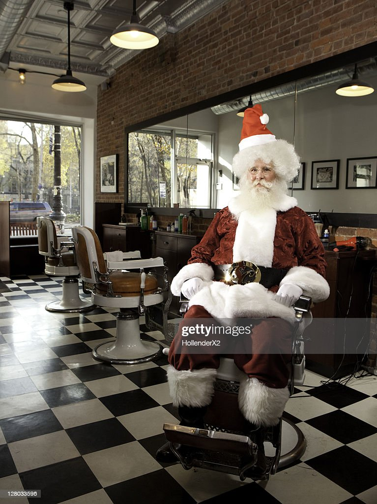 Santa with afro in barber chair : Stock Photo