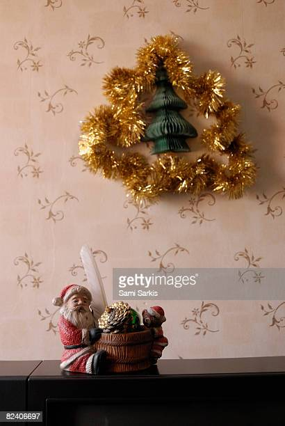 Santa-Claus on TV and Garland on wall, France