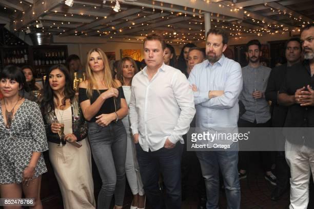 Santana Dempsey Melinna Bobadilla Carrie Lawrence David Guillod and Bryan Brucks attend actress/artist Vanessa E Garcia's Art Show with partial...