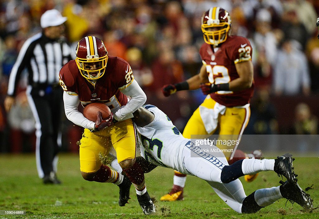 Santana Moss #89 of the Washington Redskins is tackled by Marcus Trufant #23 of the Seattle Seahawks as he gets a first down during the NFC Wild Card Playoff Game at FedExField on January 6, 2013 in Landover, Maryland.