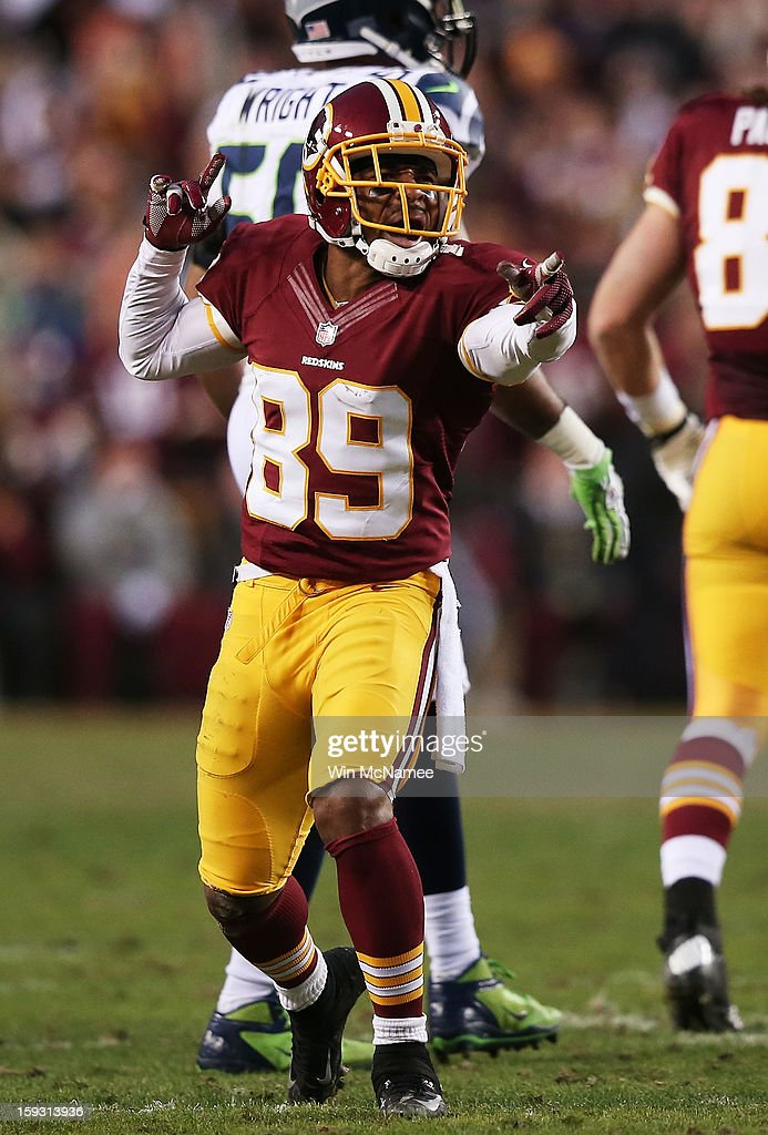 <a gi-track='captionPersonalityLinkClicked' href=/galleries/search?phrase=Santana+Moss&family=editorial&specificpeople=204490 ng-click='$event.stopPropagation()'>Santana Moss</a> #89 of the Washington Redskins reacts during the NFC Wild Card Playoff Game against the Seattle Seahawks at FedExField on January 6, 2013 in Landover, Maryland.