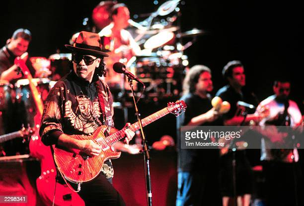 Santana performing with members of Ozomatli at Shoreline Amphitheater in Mountain View Calif on August 15th 1999 Image By Tim Mosenfelder/ImageDirect