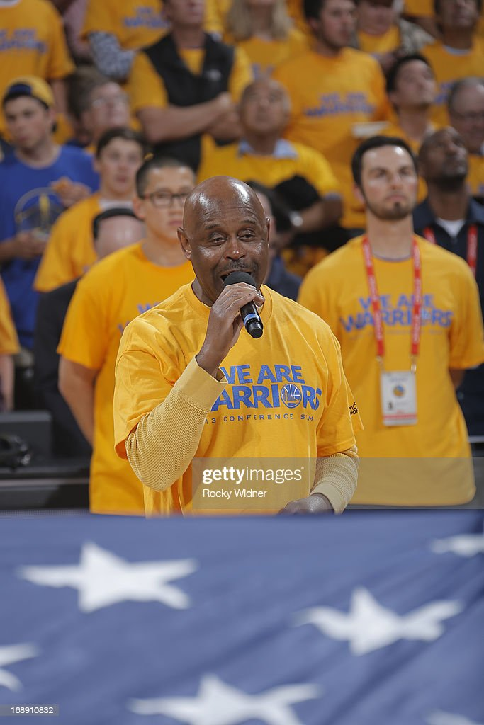 Santana's lead vocalist, Tony Lindsay, performs the National Anthem for the crowd before Game Six of the Western Conference Semifinals between the Golden State Warriors and the San Antonio Spurs during the 2013 NBA Playoffs on May 16, 2013 at Oracle Arena in Oakland, California.