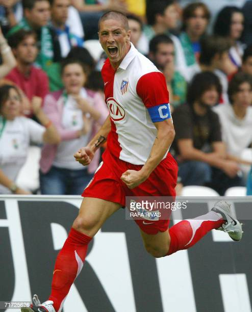 Atletico de Madrid's Fernando Torres celebrates after scoring during his Spanish League football match against Racing Santander 27 August 2006 at the...