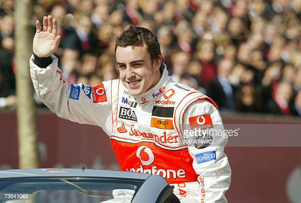 Formula 1 world champion Spain's Fernando Alonso waves to the crowd prior to performing an exhibition race in Santander part of the 150th anniversary...