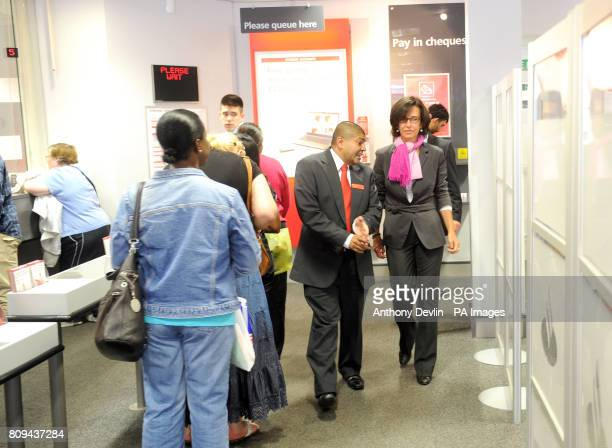 Santander's UK Chief Executive Ana Patricia Botin speaks with members of staff Nik Patel branch manager during a visit to the Walthamstow branch...