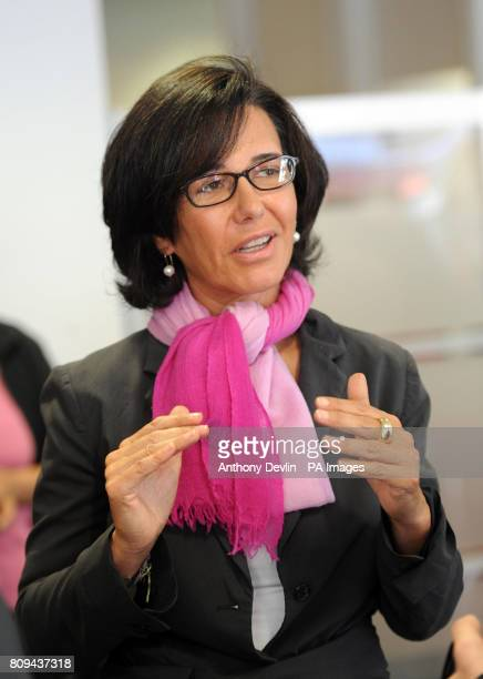 Santander's UK Chief Executive Ana Patricia Botin speaks with members of staff during a visit to the Walthamstow branch which was damaged during the...