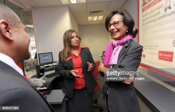 Santander's UK Chief Executive Ana Patricia Botin speaks with members of staff Nik Patel branch manager and Sabina Gelman during a visit to the...