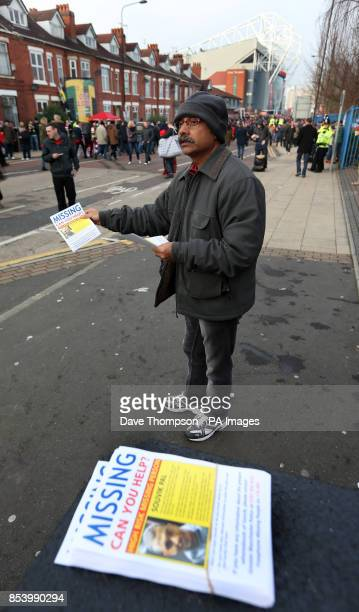 Santanu Pal father of missing Indian student Souvik Pal hands out leaflets to fans making their way to the football match between Manchester United...