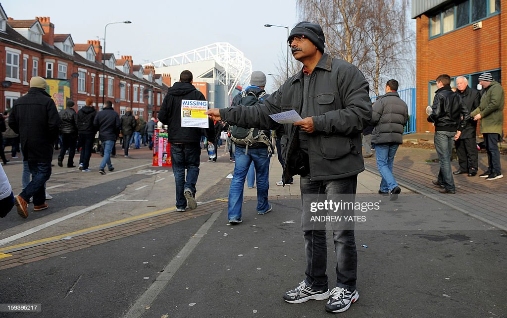Santanu Pal, father of Souvik Pal, distributes leaflets appealing for information regarding the wherabouts of his son ahead of the Manchester United versus Liverpool football match in Manchester, north-west England on January 13, 2013. Pal, an 18-year-old studying at Manchester Metropolitan University in northwest England, has been missing since celebrating New Year's Eve with friends at a nightclub in the city.
