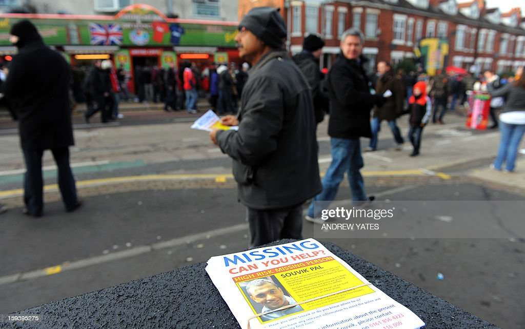 Santanu Pal, father of Souvik Pal, distributes leaflets appealing for information regarding the wherabouts of his son ahead of the Manchester United versus Liverpool football match in Manchester, north-west England on January 13, 2013. Pal, an 18-year-old studying at Manchester Metropolitan University in northwest England, has been missing since celebrating New Year's Eve with friends at a nightclub in the city. AFP PHOTO/ANDREW YATES