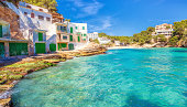 Beautiful traditional boathouses, apartments and beach at Playa Santanyi, located in the south east of Mallorca (Spain).