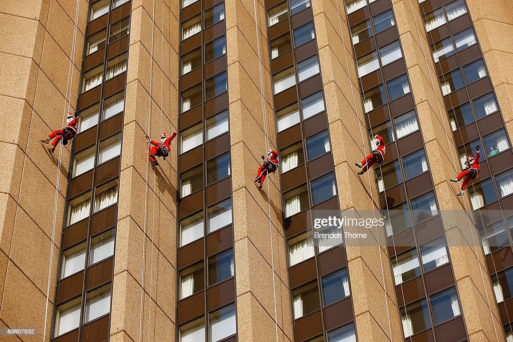 Santas abseil down the front of Sydney's Four Season's Hotel to launch the Sydney Santa Fun Run on August 5, 2009 in Sydney, Australia. The children's charity Variety are hosting the event on November 29 for which they hope to encourage 5000 Sydney-siders to wear a Santa suit and raise funds for disadvantaged children.