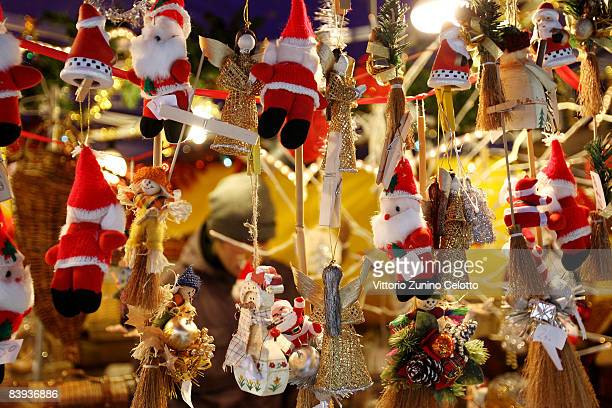 Santas await shoppers at the annual Christmas market on December 7 2008 in MilanItaly