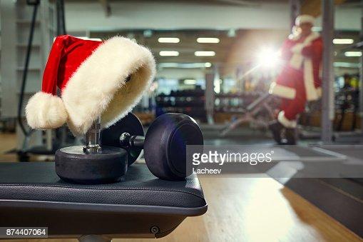 Santa's hat in the gym. : Stock Photo