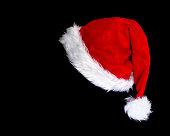santa's hat over black background
