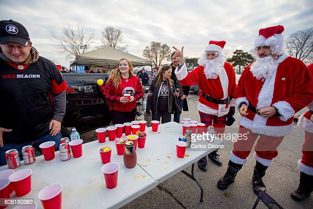 TORONTO ON NOVEMBER Santa's Phil Court and Nino Diteodoro play a game of beer pong before the game Fans of the CFL participate in a tailgate before...