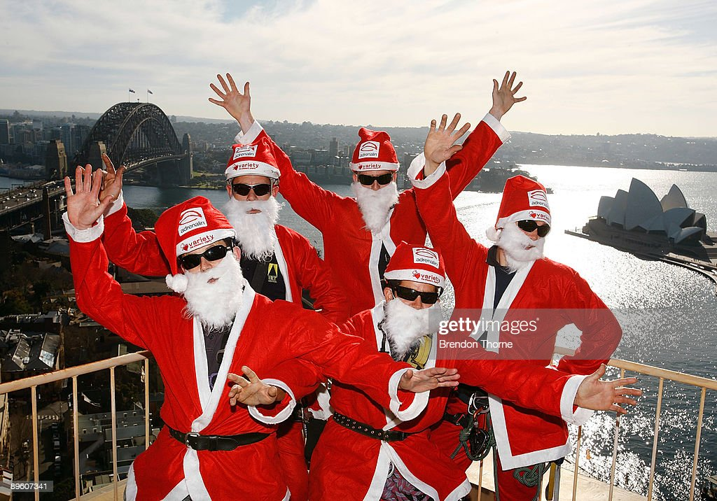 Santas pose prior to abseiling down the front of Sydney's Four Season's Hotel to launch the Sydney Santa Fun Run on August 5, 2009 in Sydney, Australia. The children's charity Variety are hosting the event on November 29 for which they hope to encourage 5000 Sydney-siders to wear a Santa suit and raise funds for disadvantaged children.