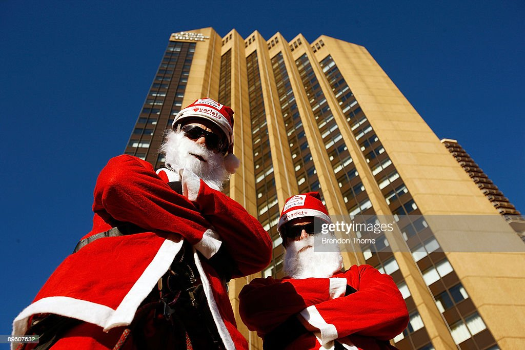 Santas poses prior to abseiling down the front of Sydney's Four Season's Hotel to launch the Sydney Santa Fun Run on August 5, 2009 in Sydney, Australia. The children's charity Variety are hosting the event on November 29 for which they hope to encourage 5000 Sydney-siders to wear a Santa suit and raise funds for disadvantaged children.