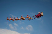 Santa's Sleigh flying above the city during Christmas