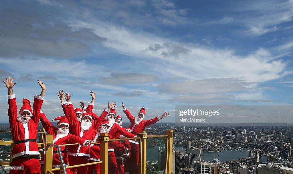 Santas visit the Skywalk at Sydney Tower on December 2, 2013 in Sydney, Australia.