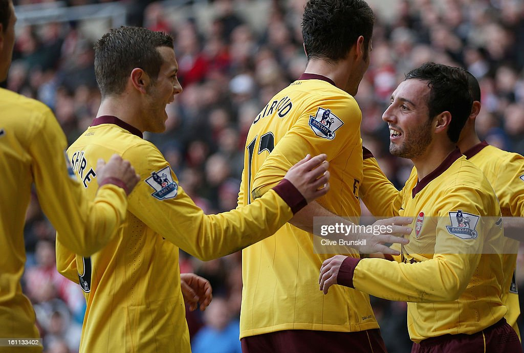 Santi Carzola of Arsenal celebrates with team mate Jack Wilshere after scoring the first goal during the Barclays Premier League match between Sunderland and Arsenal at the Stadium of Light on February 9, 2013 in Sunderland, England.