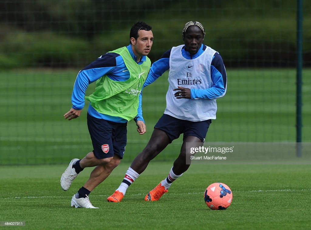 Santi Cazorla and Bacary Sagna of Arsenal during a training session at London Colney on April 11, 2014 in St Albans, England.