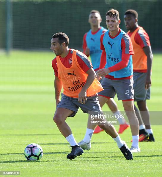 Santi Cazorla and Granit Xhaka of Arsenal during a training session at London Colney on September 23 2016 in St Albans England