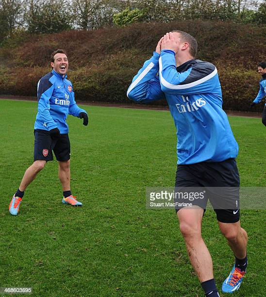 Santi Cazorla and Lukas Podolski of Arsenal during a training session at London Colney on February 11 2014 in St Albans England