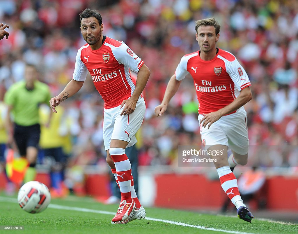 Santi Cazorla and Nacho Monreal of Arsenal during the Emirates Cup match between Arsenal and AS Monaco at Emirates Stadium on August 3, 2014 in London, England.