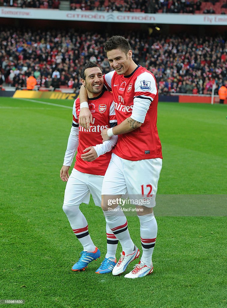 <a gi-track='captionPersonalityLinkClicked' href=/galleries/search?phrase=Santi+Cazorla&family=editorial&specificpeople=709830 ng-click='$event.stopPropagation()'>Santi Cazorla</a> and Olivier Giroud of Arsenal before the Barclays Premier League match between Arsenal and Fulham, at Emirates Stadium on November 10, 2012 in London, England.