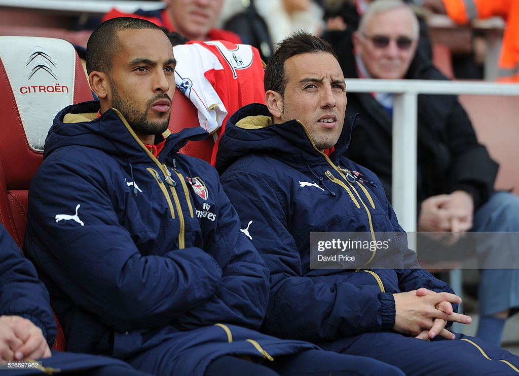 <a gi-track='captionPersonalityLinkClicked' href=/galleries/search?phrase=Santi+Cazorla&family=editorial&specificpeople=709830 ng-click='$event.stopPropagation()'>Santi Cazorla</a> and <a gi-track='captionPersonalityLinkClicked' href=/galleries/search?phrase=Theo+Walcott&family=editorial&specificpeople=451535 ng-click='$event.stopPropagation()'>Theo Walcott</a> of Arsenal on the bench before the Barclays Premier League match between Arsenal and Norwich City at on April 30th, 2016 in London, England