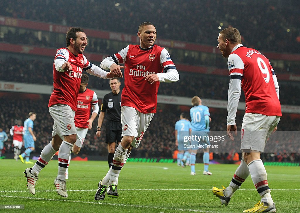 <a gi-track='captionPersonalityLinkClicked' href=/galleries/search?phrase=Santi+Cazorla&family=editorial&specificpeople=709830 ng-click='$event.stopPropagation()'>Santi Cazorla</a> (L) celebrates his goal with (C) <a gi-track='captionPersonalityLinkClicked' href=/galleries/search?phrase=Kieran+Gibbs&family=editorial&specificpeople=4192585 ng-click='$event.stopPropagation()'>Kieran Gibbs</a> and <a gi-track='captionPersonalityLinkClicked' href=/galleries/search?phrase=Lukas+Podolski&family=editorial&specificpeople=204460 ng-click='$event.stopPropagation()'>Lukas Podolski</a> during the Barclays Premier League match between Arsenal and West Ham United at Emirates Stadium on January 23, 2013 in London, England.