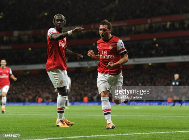 Santi Cazorla celebrates scoring for Arsenal with Bacary Sagna during the Barclays Premier League match between Arsenal and Liverpool at Emirates...