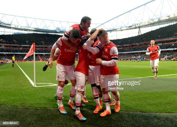 Santi Cazorla celebrates scoring his and Arsenal's 1st goal with Olivier Giroud Mathieu Flamini and Jack WIlshere during the match between Arsenal...