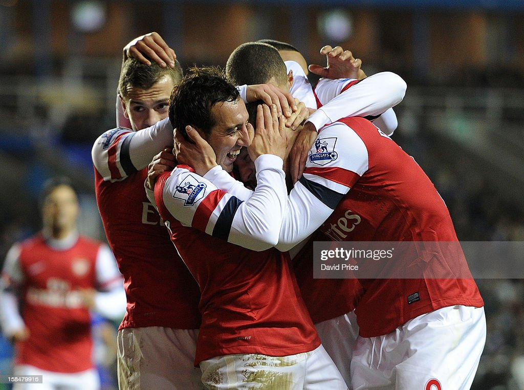 <a gi-track='captionPersonalityLinkClicked' href=/galleries/search?phrase=Santi+Cazorla&family=editorial&specificpeople=709830 ng-click='$event.stopPropagation()'>Santi Cazorla</a> celebrates scoring his third goal for Arsenal with <a gi-track='captionPersonalityLinkClicked' href=/galleries/search?phrase=Lukas+Podolski&family=editorial&specificpeople=204460 ng-click='$event.stopPropagation()'>Lukas Podolski</a> and his team mates during the Barclays Premier League match between Reading and Arsenal at Madejski Stadium on December 17, 2012 in Reading, England.