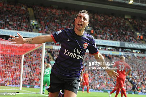 Santi Cazorla celebrates scoring the 2nd Arsenal goal during the Barclays Premier League match between Liverpool and Arsenal at Anfield on September...
