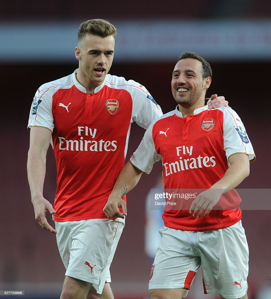 Santi Cazorla is congratulated by Calum Chambers on his assist for Arsenal's goal during the match between Arsenal U21 and Blackburn Rovers U21 at Emirates Stadium on May 3, 2016 in London, England.