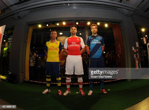 Santi Cazorla Mikel Arteta and Mathieu Flamini during the launch of Arsenal's new kits at the Puma store in Carnaby Street on July 10 2014 in London...