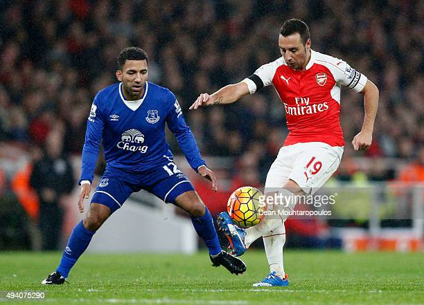 Santi Cazorla of Arsenal and Aaron Lennon of Everton compete for the ball during the Barclays Premier League match between Arsenal and Everton at...