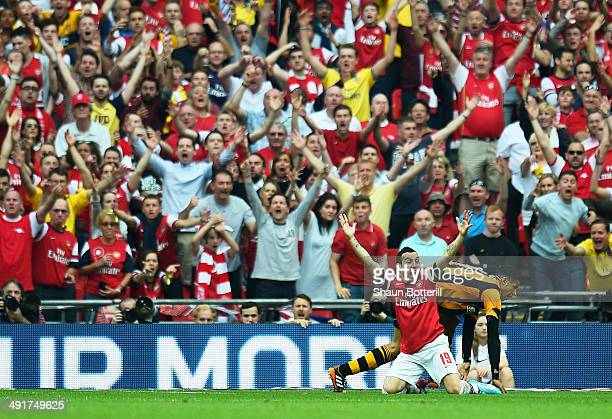 Santi Cazorla of Arsenal and Arsenal fans appeal during the FA Cup with Budweiser Final match between Arsenal and Hull City at Wembley Stadium on May...